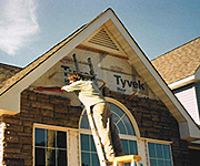 Handyman in Redwood City California fixes bricks on hosue front